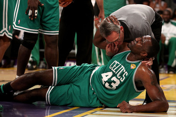 LOS ANGELES, CA - JUNE 15:  Kendrick Perkins #43 of the Boston Celtics is attended to by the trainer in the first half against the Los Angeles Lakers in Game Six of the 2010 NBA Finals at Staples Center on June 15, 2010 in Los Angeles, California.  NOTE T