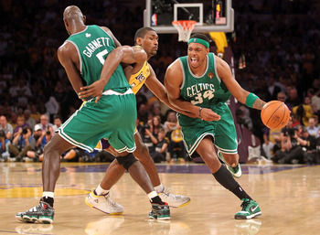 LOS ANGELES, CA - JUNE 17:  Ray Allen #20 of the Boston Celtics moves the ball as Ron Artest #37 of the Los Angeles Lakers is screened by Kevin Garnett #5 of the Celtics in the third quarter of Game Seven of the 2010 NBA Finals at Staples Center on June 1