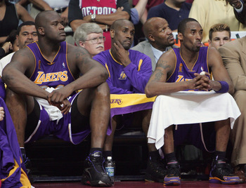 AUBURN HILLS, MI - JUNE 15: (L-R) Shaquille O'Neal #34, Gary Payton #20 and Kobe Bryant #8 of the Los Angeles Lakers look on from the bench in the fourth quarter of game five of the 2004 NBA Finals against the Detroit Pistons on June 15, 2004 at The Palac