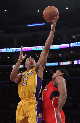 LOS ANGELES, CA - FEBRUARY 22:  Derek Fisher #2 of the Los Angeles Lakers shoots over Maurice Evans #1 of the Atlanta Hawks in the first half at Staples Center on February 22, 2011 in Los Angeles, California. NOTE TO USER: User expressly acknowledges and