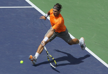 INDIAN WELLS, CA - MARCH 19:  Rafael Nadal of Spain lunges to return a forehand to Juan Martin Del Potro of Argentina during the semifinals of the BNP Paribas Open at the Indian Wells Tennis Garden on March 19, 2011 in Indian Wells, California.  (Photo by