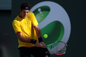 KEY BISCAYNE, FL - MARCH 23:  Juan Martin Del Potro of Argentina returns against Ricardo Mello of Brazil during the Sony Ericsson Open at Crandon Park Tennis Center on March 23, 2011 in Key Biscayne, Florida.  (Photo by Al Bello/Getty Images)