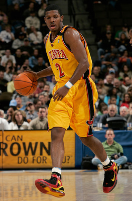 DENVER - DECEMBER 6:  Joe Johnson #2 of the Atlanta Hawks brings the ball upcourt during the game against the Denver Nuggets at Pepsi Center on December 6, 2005 in Denver, Colorado.  The Nuggets won 125-116.   NOTE TO USER: User expressly acknowledges and