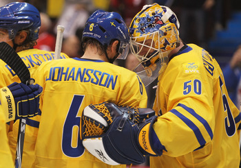 VANCOUVER, BC - FEBRUARY 19:  Magnus Johansson #6 and goalkeeper Jonas Gustavsson #50 of Sweden celebrate after defeating Belarus 4-2 during the ice hockey men's preliminary game on day 8 of the Vancouver 2010 Winter Olympics at Canada Hockey Place on Feb