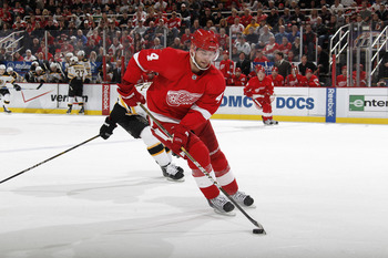 DETROIT, MI - FEBRUARY 13:  Jakub Kindl #4 of the Detroit Red Wings skates with the puck against the Boston Bruins on February 13, 2011 in Detroit, Michigan.  (Photo by Gregory Shamus/Getty Images)