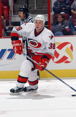RALEIGH, NC - SEPTEMBER 28:  Defenseman Igor Knyazev #38 of the Carolina Hurricanes skates on the ice during the NHL preseason game against the Washington Capitals on September 28, 2002 at the RBC Center in Raleigh, North Carolina. The Capitals won 6-1. (