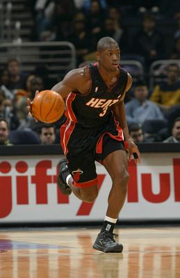 WASHINGTON - DECEMBER 26:  Dwyane Wade #3 of the Miami Heat moves the ball during the game against the Washington Wizards at the MCI Center on December 26, 2003 in Washington, DC.  The Heat won 92-84.  NOTE TO USER: User expressly acknowledges and agrees