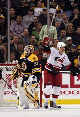 BOSTON - MAY 14:  Rod Brind'Amour #17 of the Carolina Hurricanes celebrates his goal as Tim Thomas #30 of the Boston Bruins looks on during Game Seven of the Eastern Conference Semifinal Round of the 2009 Stanley Cup Playoffs on May 14, 2009 at the TD Ban
