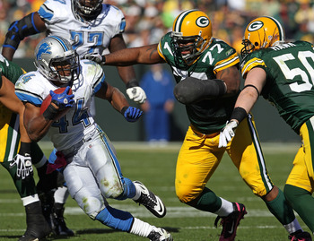 GREEN BAY, WI - OCTOBER 03: Jahvid Best #44 of the Detroit Lions moves to avoid Cullen Jenkins #77 and A.J. Hawk #50 of the Green Bay Packers at Lambeau Field on October 3, 2010 in Green Bay, Wisconsin. The Packers defeated the Lions 28-26. (Photo by Jona