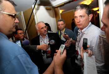 NEW ORLEANS, LA - MARCH 21:  Detroit Lions head coach Jim Schwartz (R) answers questions from the media while attending the NFL Annual Meetings at the Roosevelt Hotel on March 21, 2011 in New Orleans, Louisiana. Despite a NFL owners imposed lockout in eff