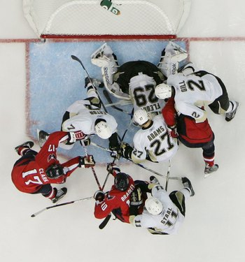 WASHINGTON - MAY 13:  Marc-Andre Fleury #29 of the Pittsburgh Penguins tends net against the Washington Capitals during Game Seven of the Eastern Conference Semifinal  Round of the 2009 Stanley Cup Playoffs at Verizon Center on May 13, 2009 in Washington,