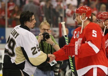 DETROIT - JUNE 12: Marc-Andre Fleury #29 of the Pittsburgh Penguins and Nicklas Lidstrom #5 of the Detroit Red Wings shake hands following Game Seven of the 2009 NHL Stanley Cup Finals at Joe Louis Arena on June 12, 2009 in Detroit, Michigan. (Photo by Br