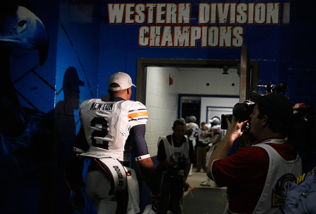 ATLANTA, GA - DECEMBER 04:  Quarterback Cam Newton #2 of the Auburn Tigers enters the locker room after their 56-17 win over the South Carolina Gamecocks during the 2010 SEC Championship at Georgia Dome on December 4, 2010 in Atlanta, Georgia.  (Photo by