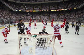 DETROIT - JUNE 4:  The Detroit Red Wings celebrate a goal as Hal Gill #2 of the Pittsburgh Penguins looks on during game six of the 2008 NHL Stanley Cup Finals at Mellon Arena on June 4, 2008 in Pittsburgh. Pennsylvania. (Photo by Bruce Bennett/Getty Imag