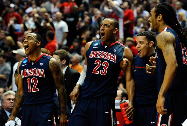 ANAHEIM, CA - MARCH 24:  Lamont Jones #12 and Derrick Williams #23 of the Arizona Wildcats reacts from the bench after a play against the Duke Blue Devils during the west regional semifinal of the 2011 NCAA men's basketball tournament at the Honda Center
