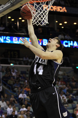 NEW ORLEANS, LA - MARCH 24:  Andrew Smith #44 of the Butler Bulldogs shoots against the Wisconsin Badgers during the Southeast regional of the 2011 NCAA men's basketball tournament at New Orleans Arena on March 24, 2011 in New Orleans, Louisiana.  (Photo