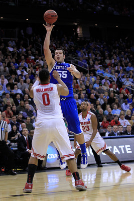 NEWARK, NJ - MARCH 25:  Josh Harrellson #55 of the Kentucky Wildcats takes a shot against Jared Sullinger #0 of the Ohio State Buckeyes during the first half of the east regional semifinal of the 2011 NCAA Men's Basketball Tournament at the Prudential Cen