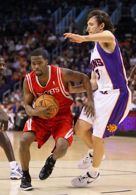 PHOENIX - JANUARY 06:  Aaron Brooks #0 of the Houston Rockets drives the ball past Steve Nash #13 of the Phoenix Suns during the NBA game at US Airways Center on January 6, 2010 in Phoenix, Arizona. The Suns defeated the Rockets 118-110.  NOTE TO USER: Us