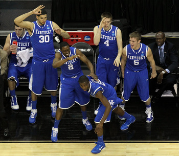 NEWARK, NJ - MARCH 25:  Eloy Vargas #30, Stacey Poole Jr. #2, Doron Lamb #20 Jon Hood #4 and Jarrod Polson #5 of the Kentucky Wildcats celebrate from the bench after play against the Ohio State Buckeyes during the east regional semifinal of the 2011 NCAA