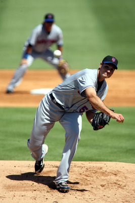 JUPITER, FL - MARCH 04:  Pitcher Chris Young #55 of the New York Mets throws against the Florida Marlins at Roger Dean Stadium on March 4, 2011 in Jupiter, Florida.  (Photo by Marc Serota/Getty Images)