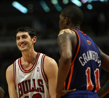 CHICAGO - JANUARY 08: Kirk Hinrich #12 of the Chicago Bulls jokes with former teammates Eddy Curry #34 and Jamal Crawford #11 of the New York Knicks during a time out on January 8, 2008 at the United Center in Chicago, Illinois. The Knicks defeated the Bu