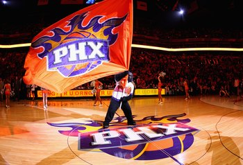 PHOENIX - DECEMBER 28:  The Phoenix Suns mascot 'Gorilla' waves a flag before the NBA game against the Los Angeles Lakers at US Airways Center on December 28, 2009 in Phoenix, Arizona.  The Suns defeated the Lakers 118-103. NOTE TO USER: User expressly ac