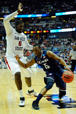 ANAHEIM, CA - MARCH 24:  Kemba Walker #15 of the Connecticut Huskies handles the ball against Brian Carlwell #5 of the San Diego State Aztecs during the west regional semifinal of the 2011 NCAA men's basketball tournament at the Honda Center on March 24,