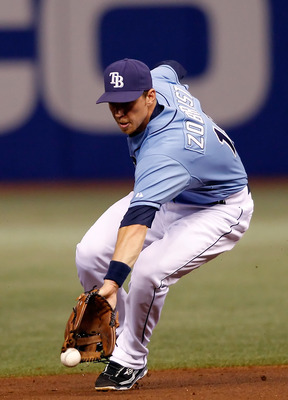 ST. PETERSBURG - AUGUST 29:  Infielder Ben Zobrist #18 of the Tampa Bay Rays cannot come up with this ground ball against the Boston Red Sox during the game at Tropicana Field on August 29, 2010 in St. Petersburg, Florida.  (Photo by J. Meric/Getty Images