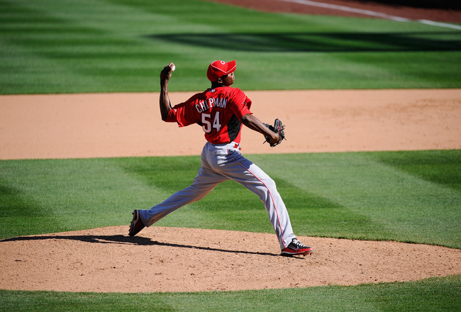 SCOTTSDALE, AZ - MARCH 14:  Pitcher Aroldis Chapman #54 of the Cincinnati Reds against the Colorodo Rockies during the spring training baseball game at Salt River Fields at Talking Stick on March 14, 2011 in Scottsdale, Arizona.  (Photo by Kevork Djansezi