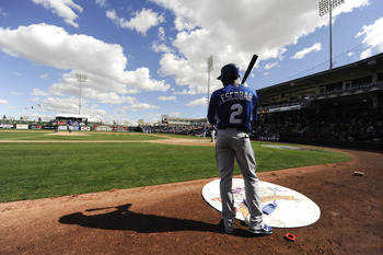SURPISE, AZ - FEBRUARY 27: Alcides Escobar #2 of the Kansas City Royals looks on from the on deck circle during a spring training game against the Texas Rangers at Surprise Stadium on February 27, 2011 in Surprise, Arizona. (Photo by Rob Tringali/Getty Im