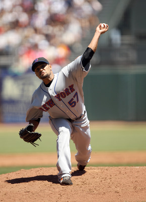SAN FRANCISCO - JULY 18:  Johan Santana #57 of the New York Mets pitches against the San Francisco Giants at AT&T Park on July 18, 2010 in San Francisco, California.  (Photo by Ezra Shaw/Getty Images)