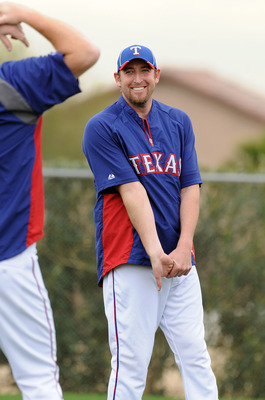 SURPRISE, AZ - FEBRUARY 18:  Brandon Webb #33 of the Texas Rangers stretches prior to spring work outs at Surprise Stadium on February 18, 2011 in Surprise, Arizona.  (Photo by Norm Hall/Getty Images)