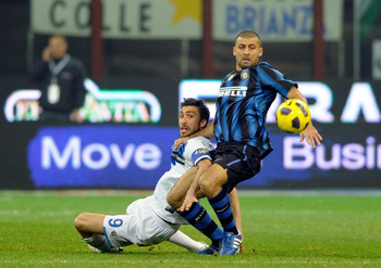 MILAN, ITALY - NOVEMBER 06:  Walter Samuel of FC Internazionale Milano and Andrea Caracciolo of Brescia Calcio compete for the ball during the Serie A match between Inter and Brescia at Stadio Giuseppe Meazza on November 6, 2010 in Milan, Italy.  (Photo b
