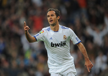 MADRID, SPAIN - NOVEMBER 07: Ricardo Carvalho of Real Madrid celebrates after scoring Real's first goal during the La Liga match between Real Madrid and Atletico Madrid at Estadio Santiago Bernabeu on November 7, 2010 in Madrid, Spain. (Photo by Denis Doy