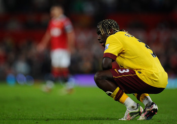 MANCHESTER, ENGLAND - MARCH 12:  Bacary Sagna of Arsenal looks dejected during the FA Cup sponsored by E.On Sixth Round match between Manchester United and Arsenal at Old Trafford on March 12, 2011 in Manchester, England.  (Photo by Clive Mason/Getty Imag