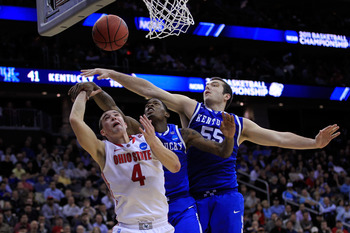 NEWARK, NJ - MARCH 25:  Josh Harrellson #55 of the Kentucky Wildcats blocks a shot of Aaron Craft #4 of the Ohio State Buckeyes during the east regional semifinal of the 2011 NCAA Men's Basketball Tournament at the Prudential Center on March 25, 2011 in N