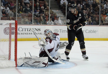 ANAHEIM, CA - FEBRUARY 27:  Goaltender Peter Budaj #31 of the Colorado Avalanche lunges to make a save as Corey Perry #10 of the Anaheim Ducks pursues at Honda Center on February 27, 2011 in Anaheim, California.  (Photo by Jeff Gross/Getty Images)