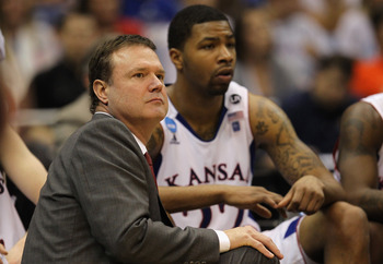 SAN ANTONIO, TX - MARCH 25:  Head coach Bill Self of the Kansas Jayhawks and Marcus Morris look on during the southwest regional of the 2011 NCAA men's basketball tournament at the Alamodome against the Richmond Spiders on March 25, 2011 in San Antonio, T