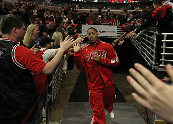 CHICAGO, IL - MARCH 25: Derrick Rose #1 of the Chicago Bulls runs to the court before a game against the Memphis Girzzlies at the United Center on March 25, 2011 in Chicago, Illinois. Rose will donate $1,000.00 for every point he scored tonight to the Dir