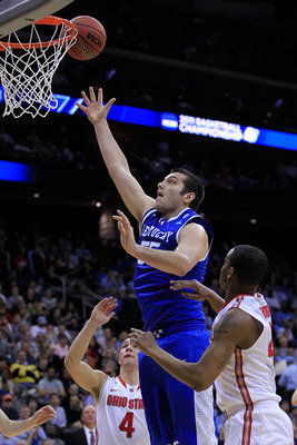 NEWARK, NJ - MARCH 25:  Josh Harrellson #55 of the Kentucky Wildcats takes a shot against the Ohio State Buckeyes during the first half of the east regional semifinal of the 2011 NCAA Men's Basketball Tournament at the Prudential Center on March 25, 2011
