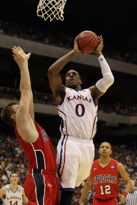 SAN ANTONIO, TX - MARCH 25:  Thomas Robinson #0 of the Kansas Jayhawks goes to the basket against the Richmond Spiders during the southwest regional of the 2011 NCAA men's basketball tournament at the Alamodome on March 25, 2011 in San Antonio, Texas.  (P
