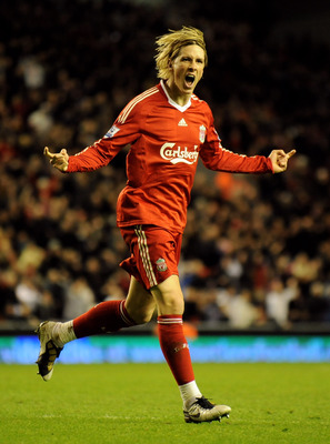 LIVERPOOL, ENGLAND - MARCH 15:  Fernando Torres of Liverpool celebrates scoring his team's fourth goal during the Barclays Premier League match between Liverpool and Portsmouth at Anfield on March 15, 2010 in Liverpool, England. (Photo by Michael Regan/Ge