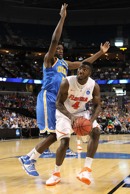 TAMPA, FL - MARCH 19:  Patric Young #4 of the Florida Gators drives against Anthony Stover #0 of the UCLA Bruins during the third round of the 2011 NCAA men's basketball tournament at St. Pete Times Forum on March 19, 2011 in Tampa, Florida.  (Photo by Mi