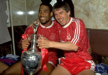 1 May 1990:  John Barnes and Peter Beardsley of Liverpool celebrate with the trophy after the Barclays League Division One match against Derby County at Anfield in Liverpool, England. Liverpool won the match 1-0 and became league champions. \ Mandatory Cr