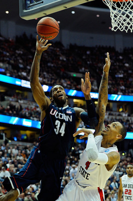 ANAHEIM, CA - MARCH 24:  Alex Oriakhi #34 of the Connecticut Huskies drives to the basket against Malcolm Thomas #4 of the San Diego State Aztecs during the west regional semifinal of the 2011 NCAA men's basketball tournament at the Honda Center on March