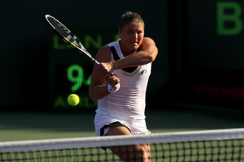 KEY BISCAYNE, FL - MARCH 25:  Dinara Safina of Russia follows through on a return against Vera Zvonareva of Russia during the Sony Ericsson Open at Crandon Park Tennis Center on March 25, 2011 in Key Biscayne, Florida.  (Photo by Al Bello/Getty Images)