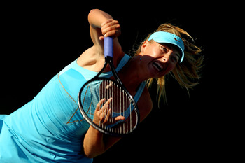 KEY BISCAYNE, FL - MARCH 26:  Maria Sharapova of Russia serves against Sabine Lisicki of Germany during the Sony Ericsson Open at Crandon Park Tennis Center on March 26, 2011 in Key Biscayne, Florida.  (Photo by Al Bello/Getty Images)
