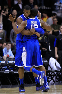 NEWARK, NJ - MARCH 25:  Terrence Jones #3 hugs teammates Brandon Knight #12 of the Kentucky Wildcats after defeating the Ohio State Buckeyes in the east regional semifinal of the 2011 NCAA Men's Basketball Tournament at the Prudential Center on March 25,