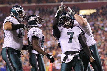 LANDOVER, MD - NOVEMBER 15: Michael Vick #7 of the Philadelphia Eagles is congratulated by team mate Todd Herremans #79 after scoring a touchdown against the Washington Redskins on November 15, 2010 at FedExField in Landover, Maryland.  (Photo by Chris Mc