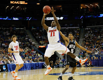 NEW ORLEANS, LA - MARCH 26:  Erving Walker #11 of the Florida Gators shoots against the Butler Bulldogs during the Southeast regional final of the 2011 NCAA men's basketball tournament at New Orleans Arena on March 26, 2011 in New Orleans, Louisiana.  (Ph